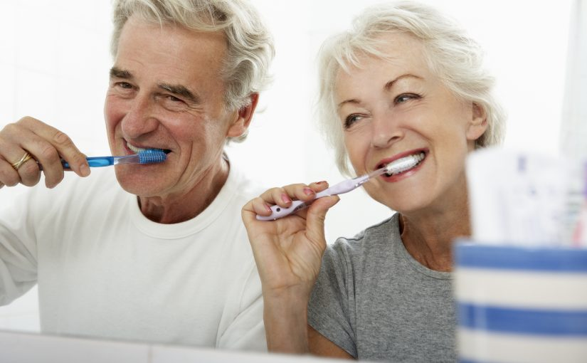 seniors brushing their teeth